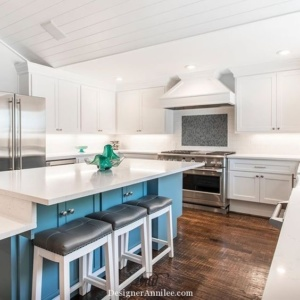 Modern vintage kitchen design, fully handicap accessible. White shaker cabinets, white subway tile backsplash, blue island, Carrara marble style quartz countertops, blue mosaic accent tile.