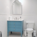 Classic style, with modern function & Color! This is the new powder room, all clean, crisp & traditional, with a modern pop of blue in the vanity. White hexagon floor tile, classic white subway wall tile, Carrara marble style quartz countertop, custom vanity.