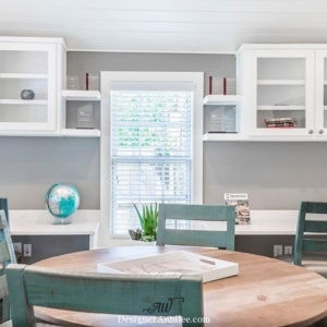 Classic white shaker cabinets, Carrara style quartz counters, open shelving, glass front cabinets. This room could be an office, craft room, homeschool room.